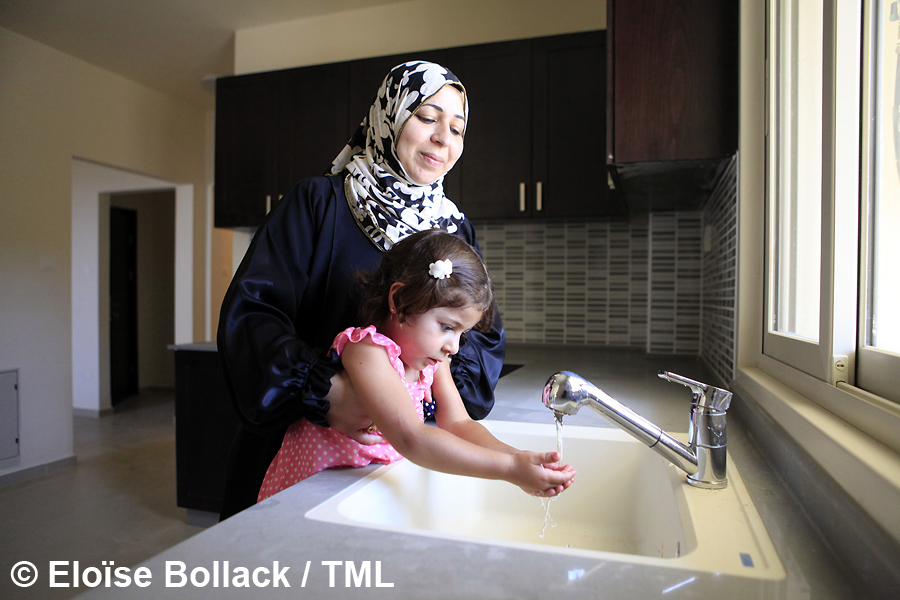 Whilst Hanadi Abu Zahra turns on the tap in the kitchen of her new home in Rawabi, her daughter is elated to see the water flowing.