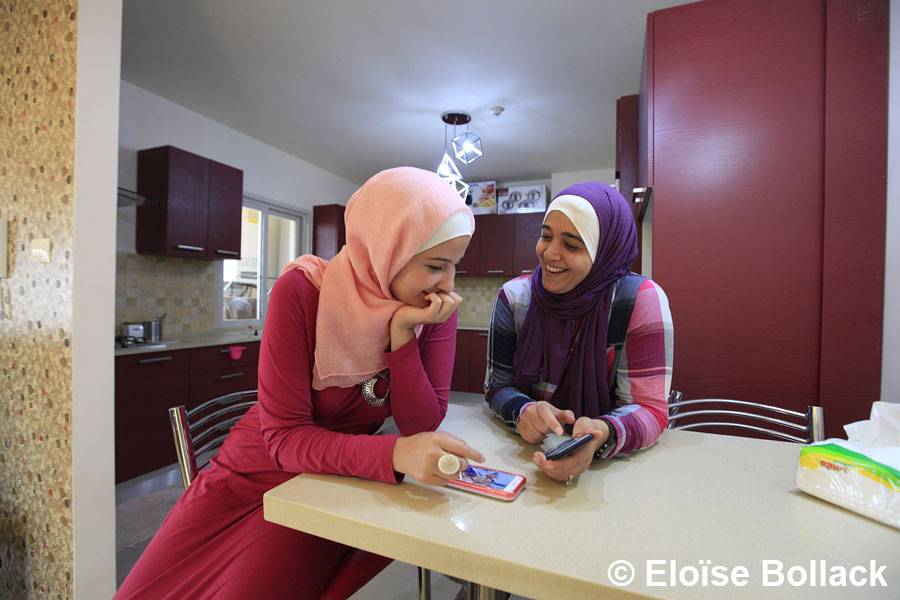Hana and Tuka Kamal, one of the first family to take up residency in the first neighborhood of Rawabi, discuss in their kitchen.